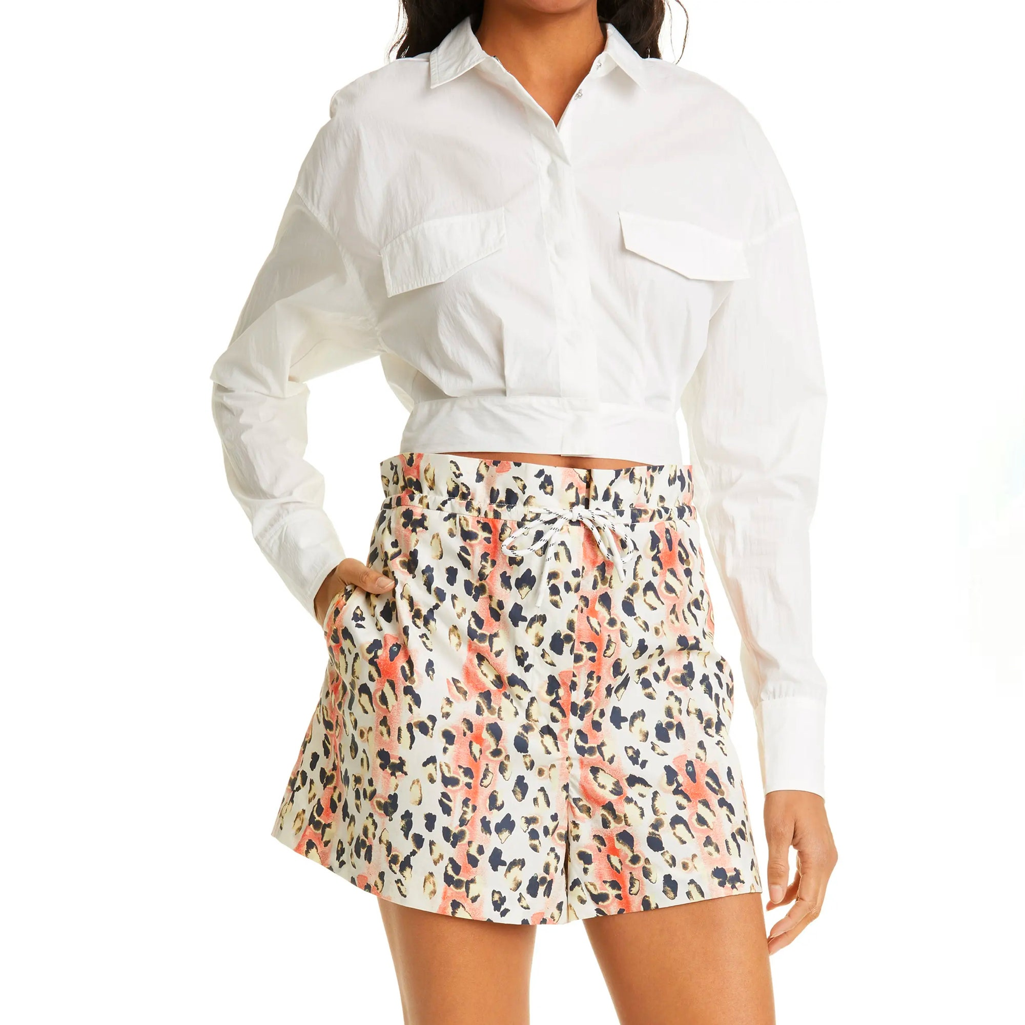 model wearing white button down and mini skirt