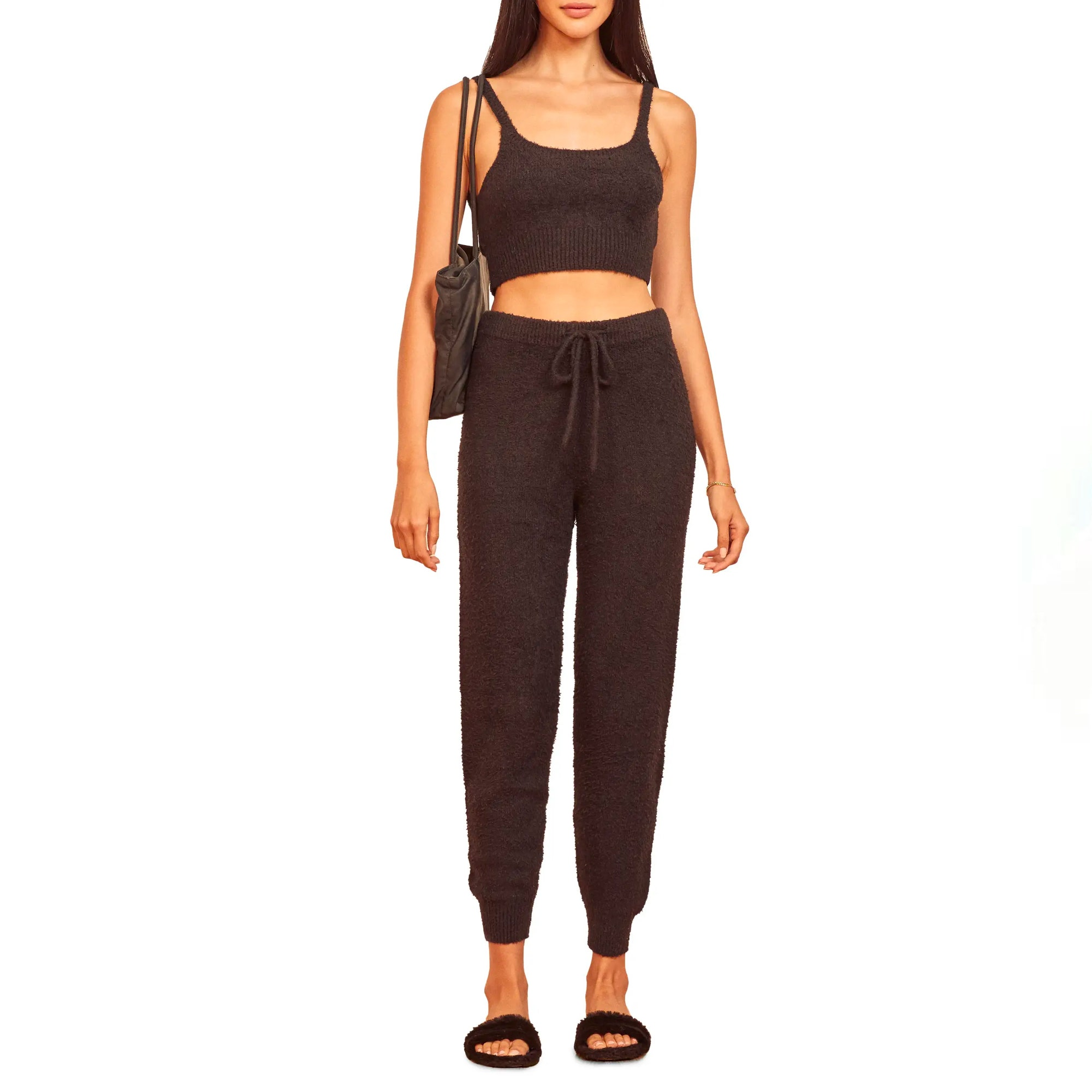 model wearing black joggers and matching tank top