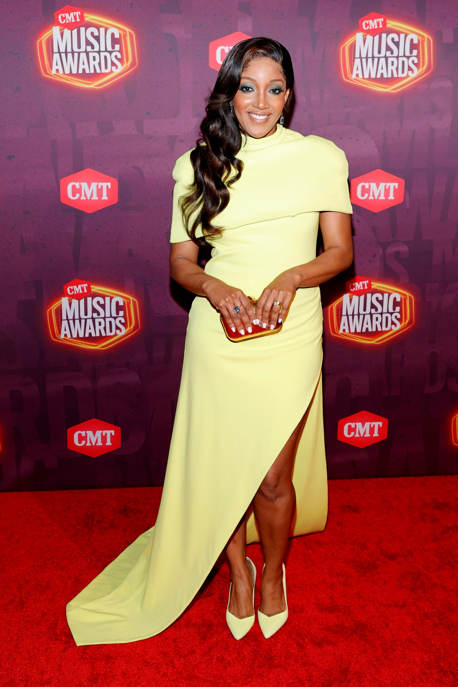 Image may contain Mickey Guyton Human Person Fashion Premiere Red Carpet and Red Carpet Premiere