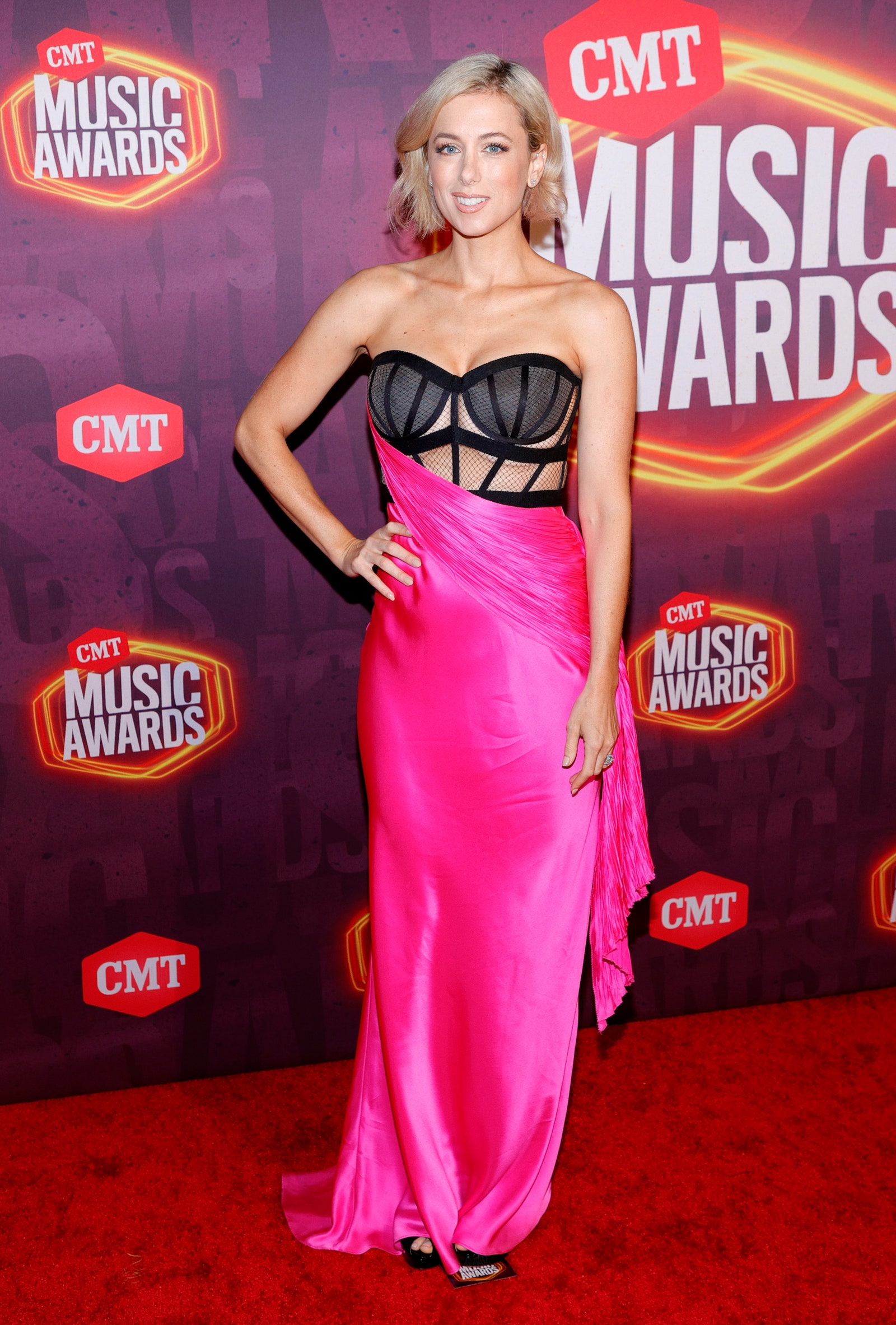 Image may contain Iliza Shlesinger Fashion Human Person Premiere Red Carpet Red Carpet Premiere Clothing and Apparel