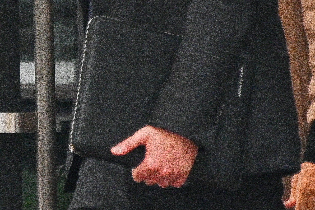 NEW YORK NEW YORK SEPTEMBER 23 Prince Harry Duke of Sussex with a portfolio briefcase inscribed with Archies Papa is...